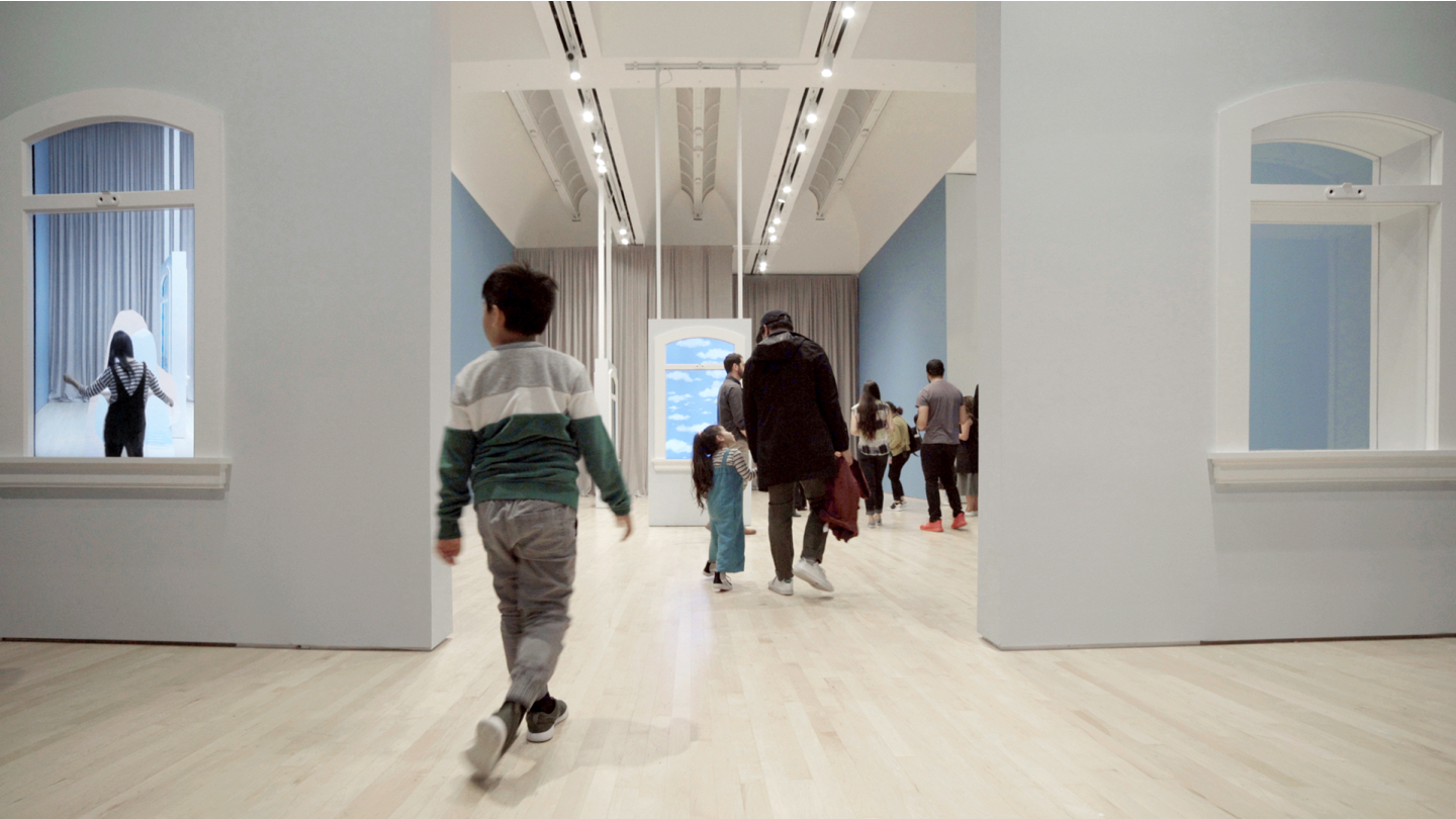Visitors enjoy the AR-transformed artworks at SFMOMA